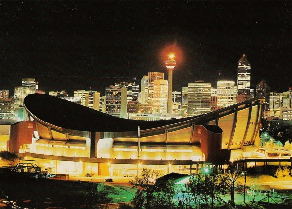 photograph of Saddledome with city at night