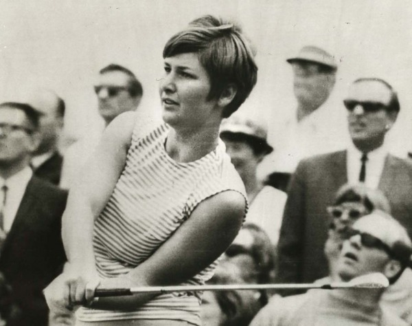 photograph of Sandra Post holding golf club