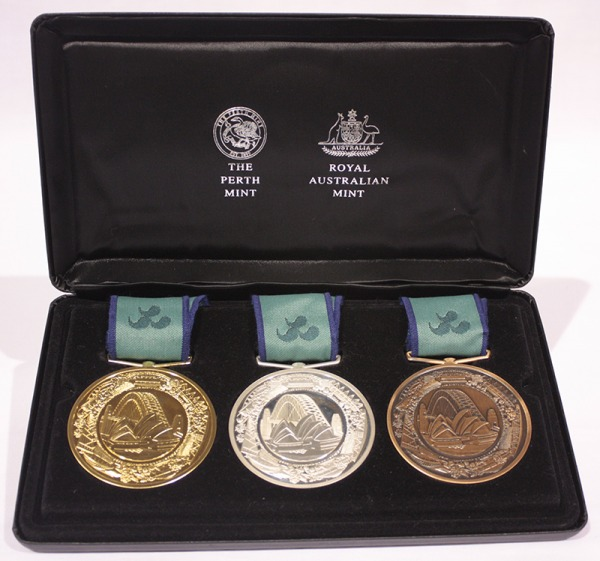 set of gold, silver and bronze Paralympic medals in case