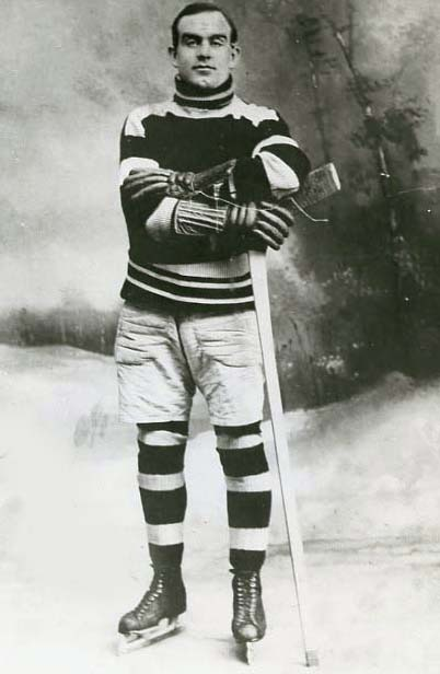 photograph of Fred Taylor in hockey uniform