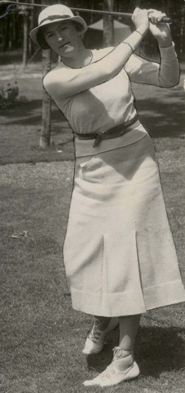 photograph of a young Ada Mackenzie swinging golf club