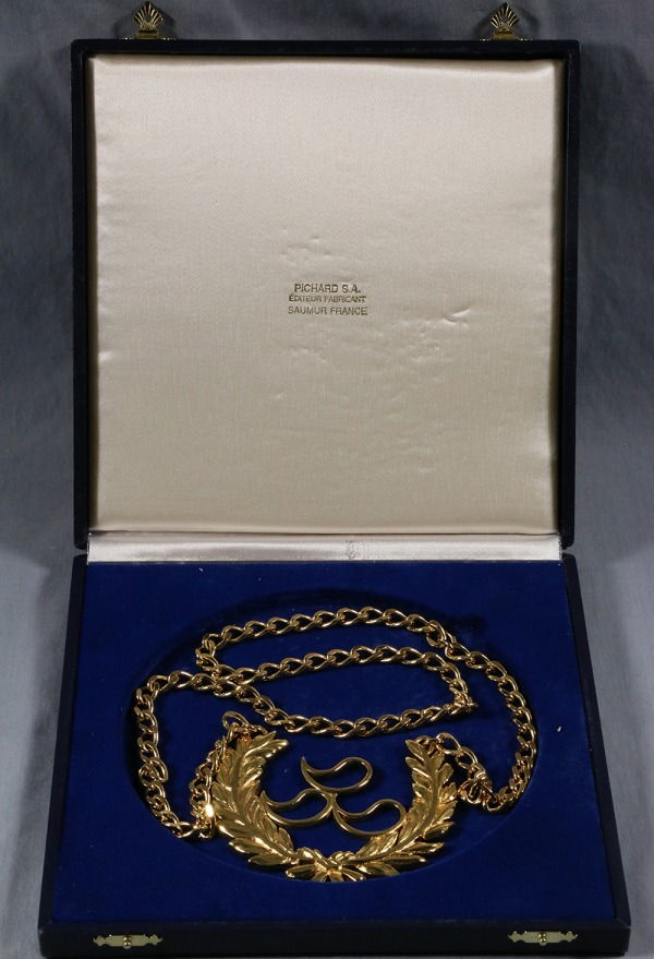 IPC award with gold logo and wreath on chain