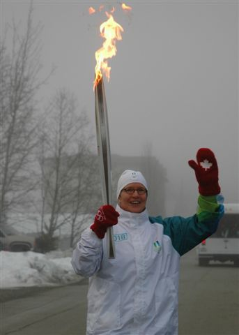 photograph of Marion Lay with Vancouver 2010 torch