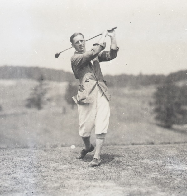 photograph of Albert Murray swinging golf club