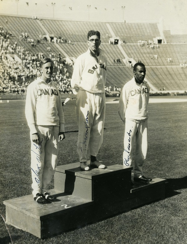 photograph of Phil Edwards on far right on podium