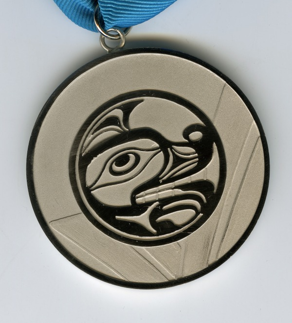 Silver medal with image of wolf head
