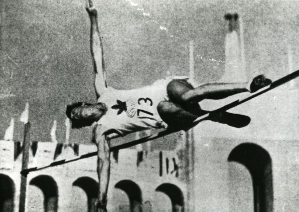 photograph of Duncan McNaughton jumping over high bar