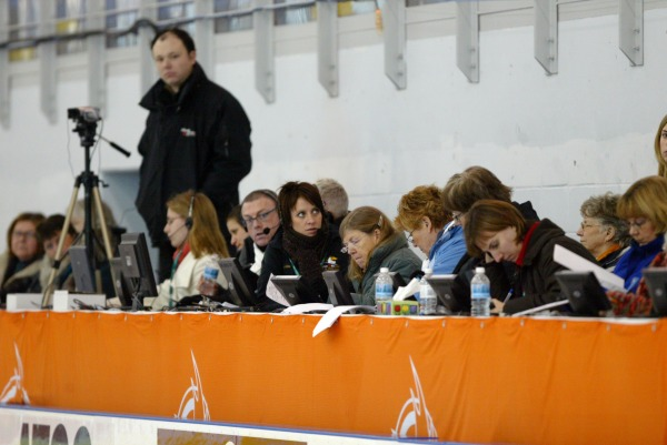 Photograph of figure skating judges at table