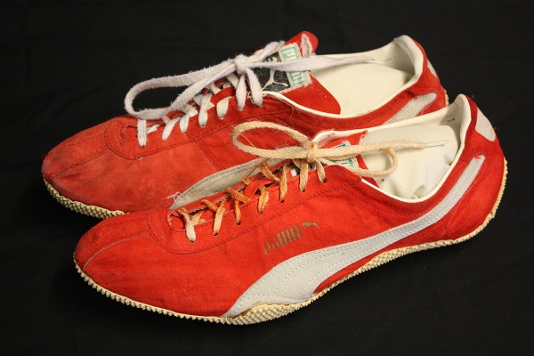 red and white track shoes