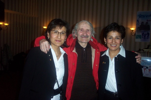 photograph Sharon and Shirley Firth with Father Mouchet