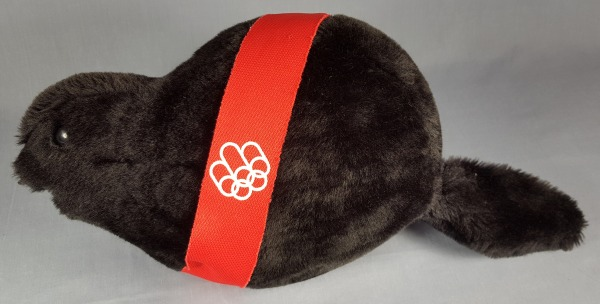 black toy beaver with red band