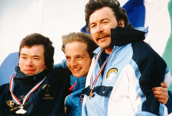 Image of three athletes with ulu medals