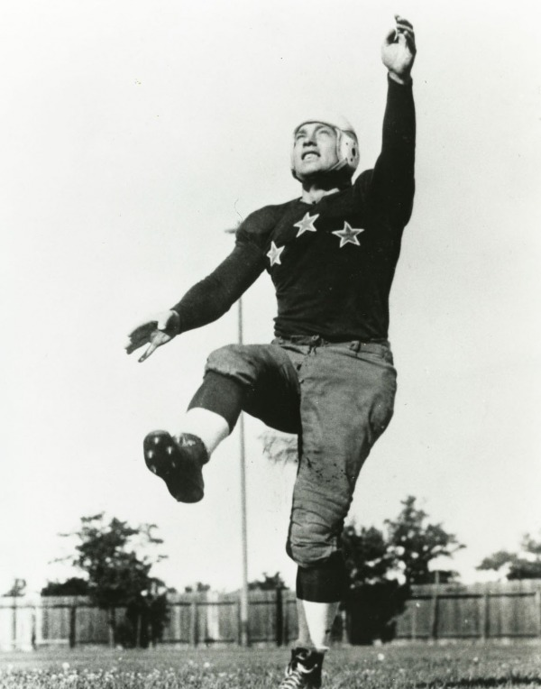 photograph of Hugh Stirling kicking football