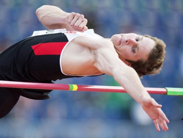 photograph of Derek Drouin jumping over high bar