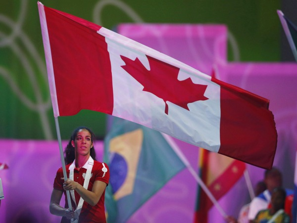 Photograph of Kia Nurse carrying the Canadian flag
