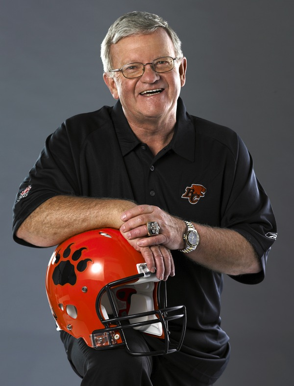 photograph of Bob Ackles with BC Lions football helmet
