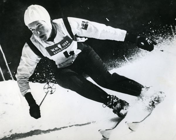 photograph of Lucile Wheeler skiing downhill wearing white helmet