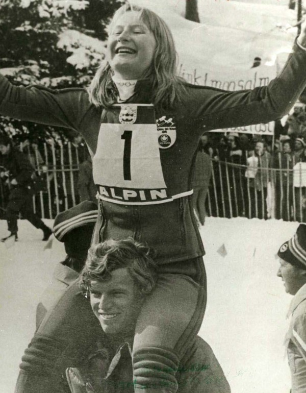 Photograph of Kathy Kreiner sitting on shoulders of team mate Jungle Jim Hunter