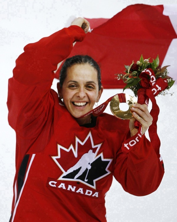 photograph of Danielle Goyette with medal Canadian flag