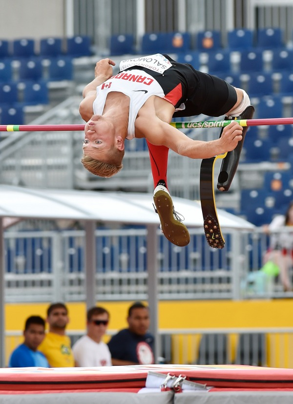 photograph of Cody Salomons jumping over high bar