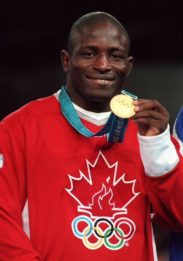 photograph of Daniel Igali with gold medal