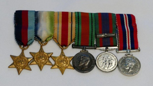 bar of six medals with ribbons