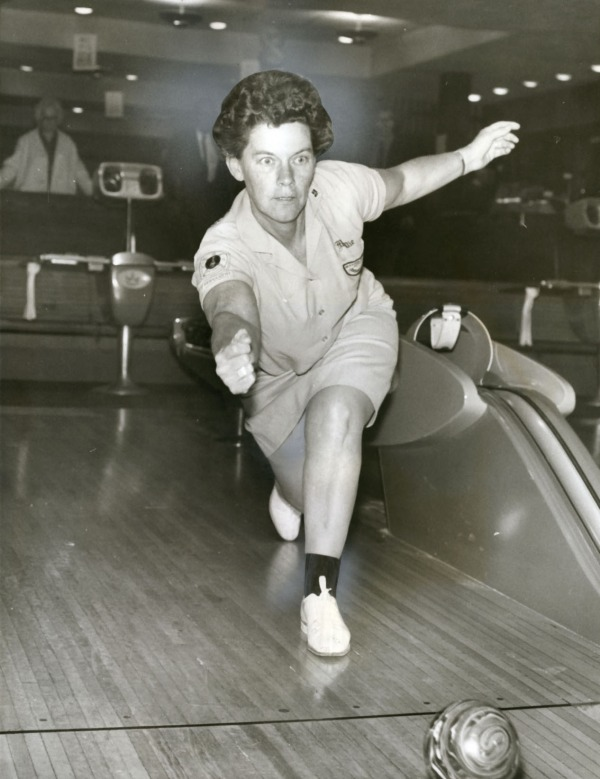 photograph of woman throwing bowling ball