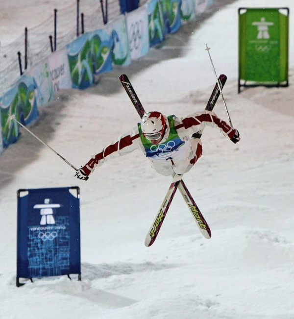photograph of Alexandre Bilodeau doing jump in moguls competition