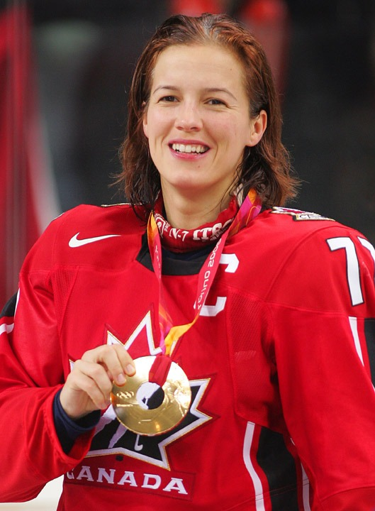photograph of Cassie Campbell with Olympic gold medal