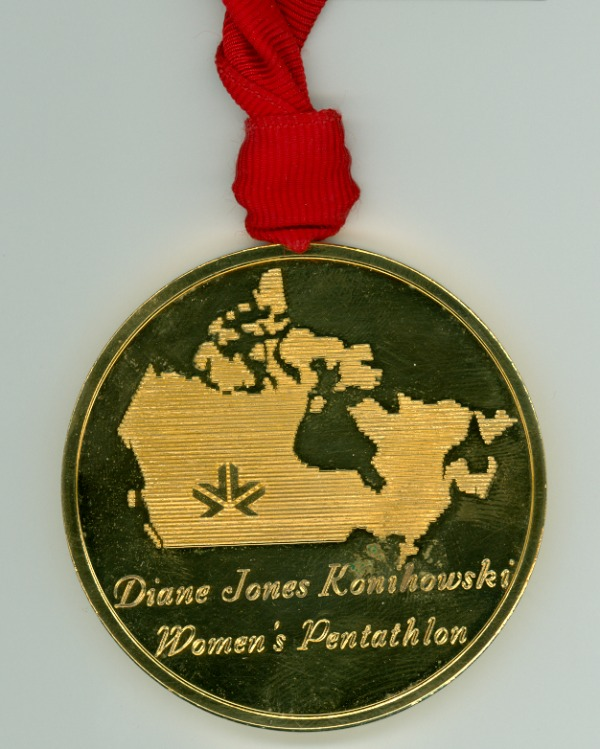 gold medal with Edmonton logo on map of Canada