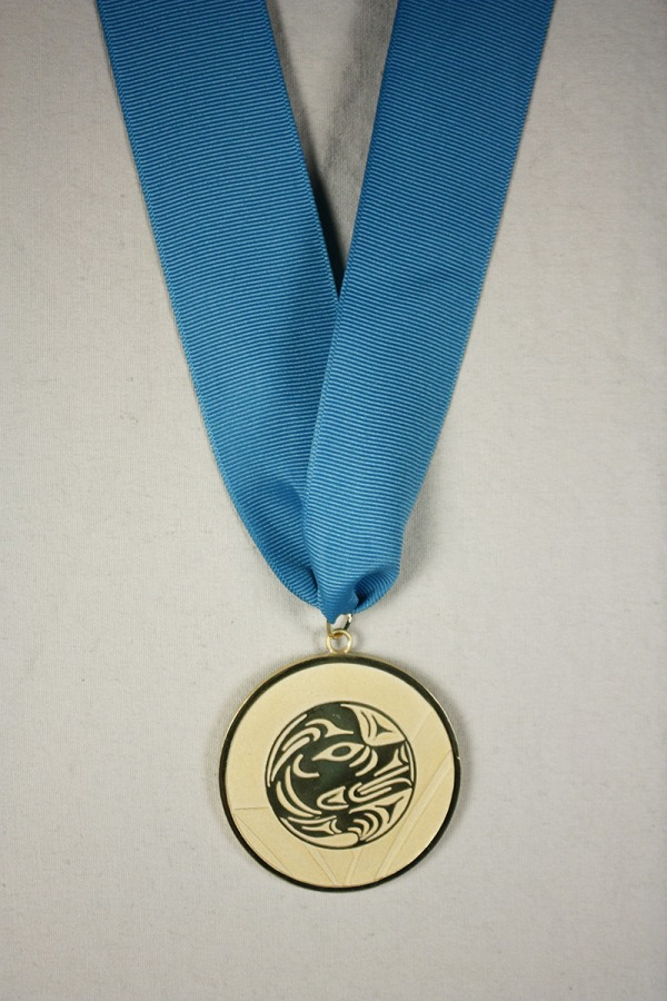 Gold medal with image of wolf