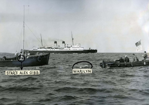 photograph of three boats and swimmer in water marked Star's Alex Gibb and Marilyn