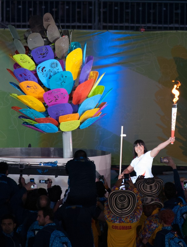 photograph of Chantal Petitclerc with relay torch