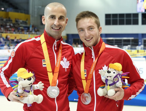 photograph of Benoit Huot and Alexander Elliot with medals and mascots