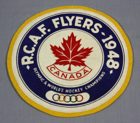 circular crest which reads RCAF Flyers 1948 Olympic   World s Hockey  Champions with red maple leaf b1964db3d6e