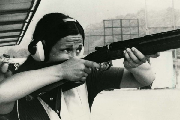Photograph of Susan Nattrass holding rifle while shooting