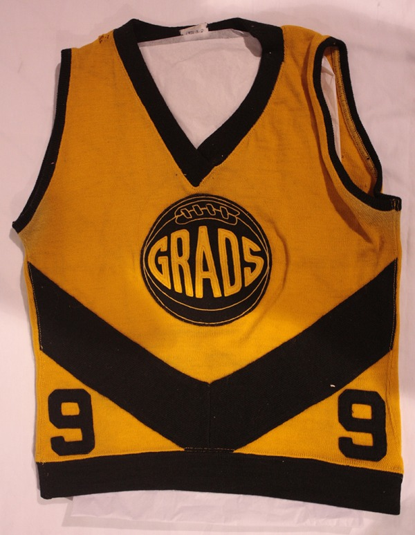 black and yellow Edmonton Grads basketball tunic with number 9