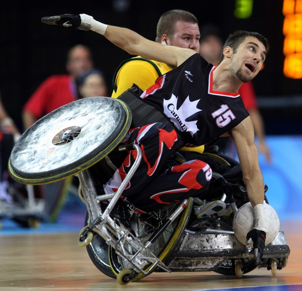 photograph of Canadian player with wheelchair tipping)