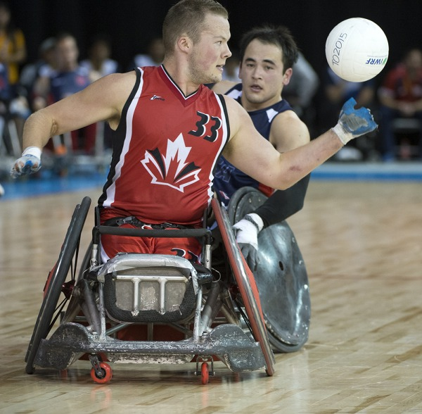photograph of Zak Madell playing wheelchair rugby
