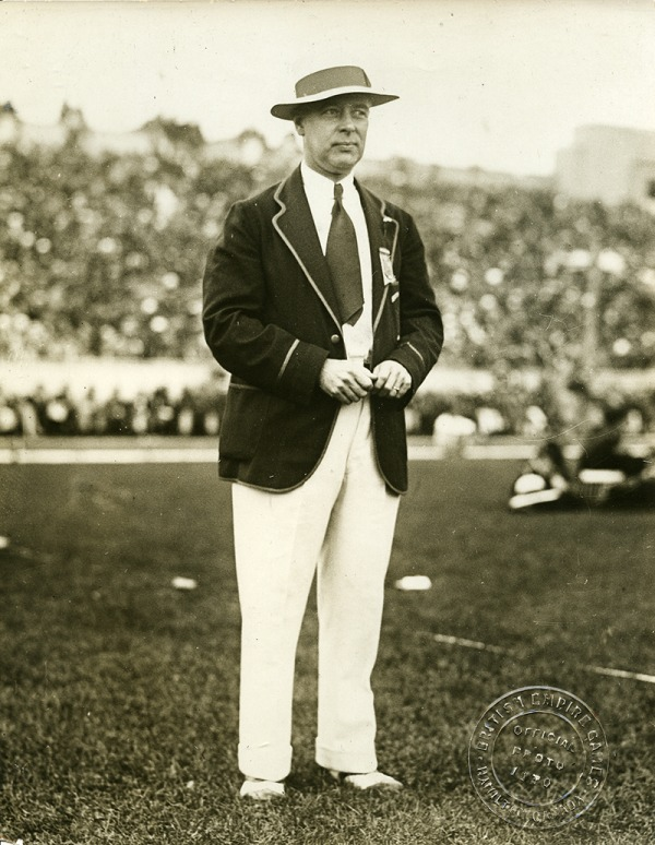Photograph M.M. Robinson in a dark blazer and hat