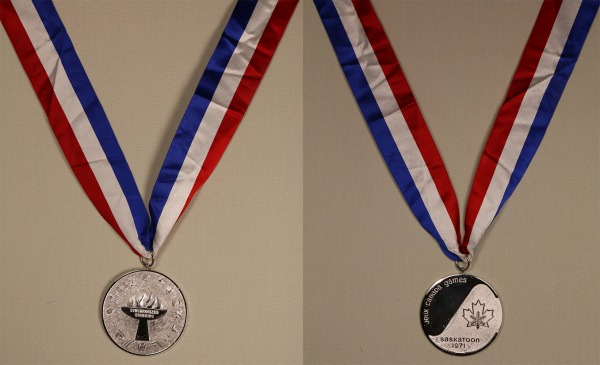 Silver medal on red, white and blue ribbon with maple leaf/snowflake logo