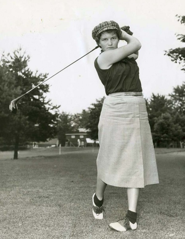 photograph of Marlene Stewart Streit swinging golf club