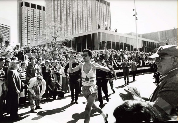 photograph of Jerome Drayton breaking finish line in Boston