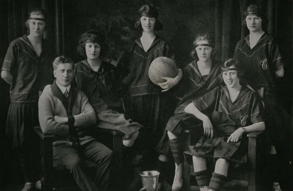 photograph of team of six women and Percy Page