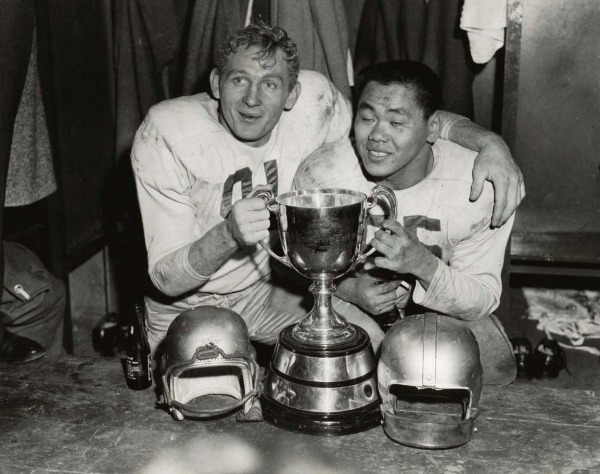 photograph of Normie Kwong and Jackie Parker with Grey Cup