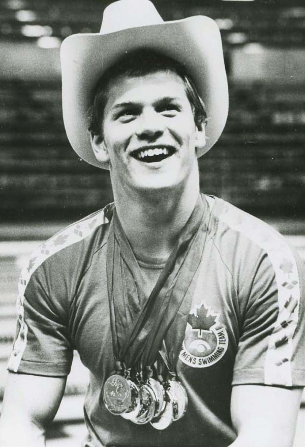 Photograph of Graham Smith with medals and wearing a cowboy hat