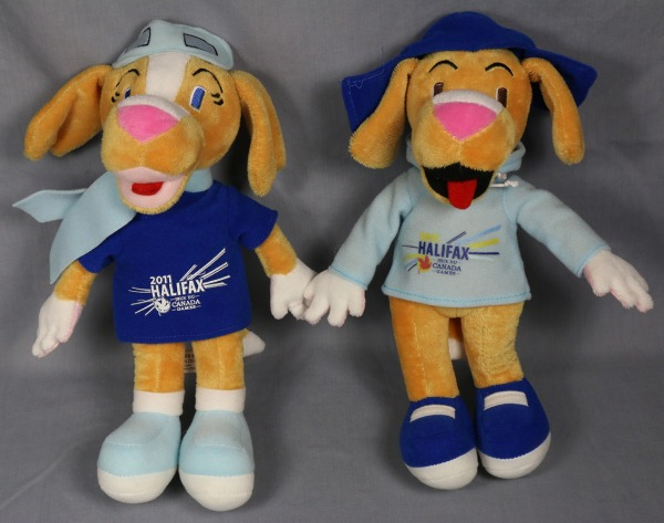 Toy dogs wearing hats and sweaters with logo