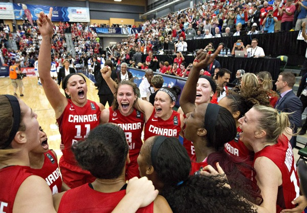 photograph of Canadian women's basketball team celebrating victory