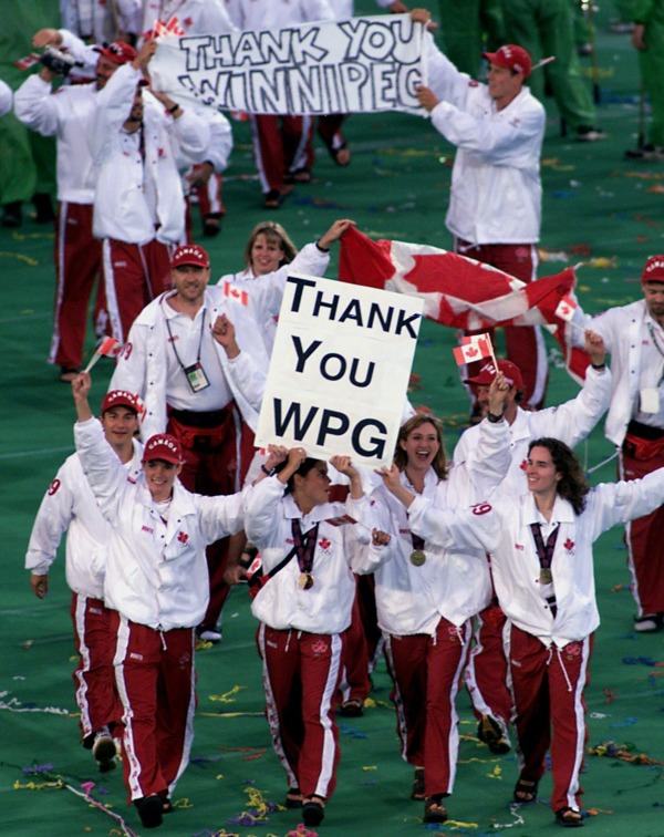 photograph of Canadian athletes with sign Thank You WPG