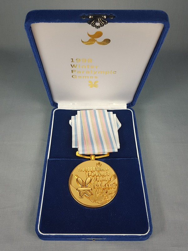 set of gold, silver and bronze medals in cases